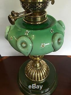 An Antique Green Oil Lamp