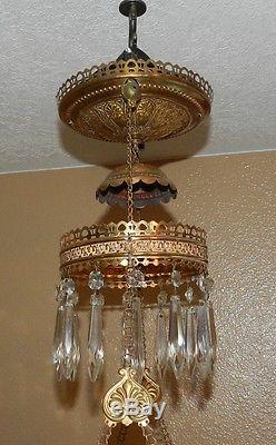 Antique Brass hanging oil lamp with glass chimney and floral glass shade