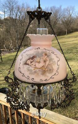 Antique Hanging Oil Lamp Cherub design in Iron Fixture