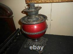 Antique Juno oil lamp fiery deco red with ornate trim, never electrified