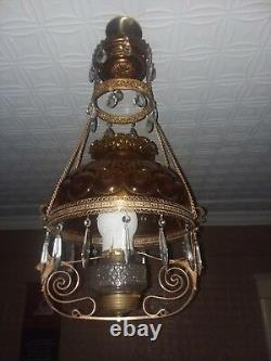 Antique hanging brass oil lamp