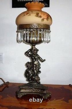 Large and one of a kind Antique Victorian cherub Oil Lamp with Bronze Statue