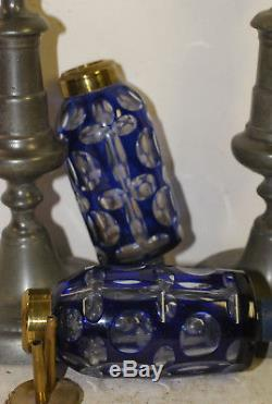 Pair Sandwich glass whale oil lamps, blue cut to clear, on pewter push-up sticks